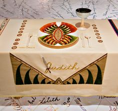 Judith place setting (1974-79) The Dinner Party by Judy Chicago. When the city of Bethulia was under attack by the Assyrian army headed by Holofernes in 6th century BC, Judith devised a plan to reclaim her people's land. She requested a meeting with Holofernes to discuss a strategy to help his army win & he was mesmerized by her beauty. He invited her to a feast after which she & her maid decapitated the intoxicated Holofernes. The Assyrian army fled & the people of Bethulia were left in…