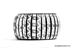 A personal favorite from my Etsy shop https://www.etsy.com/listing/177961361/floral-print-daisy-bangle-black-white