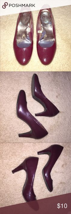 Maroon patent heels, Women's size 9 Merona brand pumps. Maroon - almost deep purple - colored, shiny. Heel is ~3-3.5 inches tall. Great shoes for work! In decent condition, inside is showing wear (see pictures). But with a little buffing could look in almost-new condition on the outside! Women's size 9. Shoes Heels