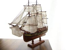 Vintage Schooner, Pirate Ship, Ship w/ Sails (Wood, Brass, Fabric). $50.00, via Etsy.
