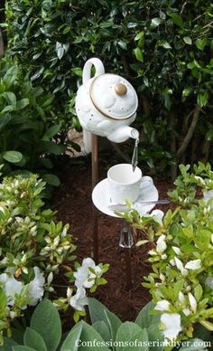 Not a working water feature.  Look closely--that's a crystal coming out of the spout.  Cute!