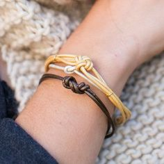 With this easy and quick 4 Step Leather Knotted Bracelet, you will have a simple, yet beautiful, DIY bracelet to wear. This easy leather tutorial shows you how to make a bracelet by simply just knotting leather cords together.