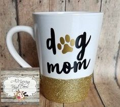 "Mommy of a dog? Here is your mug! Glitter dipped bottom is gold and accented with a gold paw paired with black design. 14oz ceramic mug At checkout if you do not need shipping just apply the code ""Loc"