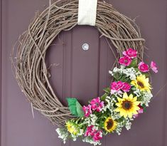 A spring wreath I made for my door using Walmart items. Check out my YouTube channel for more! www.youtube.com/thethriftychica