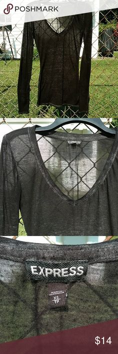 3 for $5! 🆓 Item! Expres Sheer Heather Black Tee See my sale listing for sale details!  Express brand long sleeve t-shirt in heather black. Semi-sheer; pictures in bright sunlight make it look more sheer than it is. V-neck; very figure flattering! Extremely soft! 50% polyester, 38% cotton, 12% rayon. Mostly EUC but small snag on left arm. From a smoke free home. Express Tops Tees - Long Sleeve