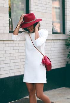 Red accessories elevate this look from simple to stunning.