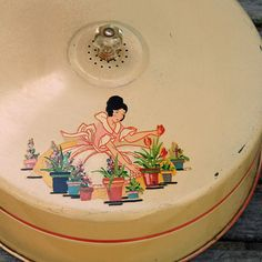 I Love this 50s decal of a lady gardening. I have one tin with this same decal but I want MORE!