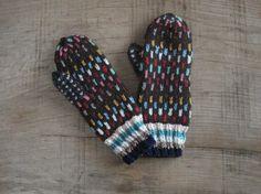 Handknitted women woollen mittens