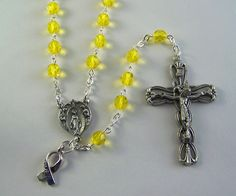 Yellow Awareness Rosary by FaithHopeAndBeads on Etsy Yellow is the awareness color for: *Adenosarcoma *Bladder Cancer (alternate colors are marigold, blue, and purple) *Carbon Monoxide Poisoning *Endometriosis *Ewings Sarcoma *Hydrocephalus *Liver Cancer *Liver Disease *Missing Children (alternate color is green) *Myxoid Liposarcoma *Osteosarcoma (alternate color is gold) *Sarcoma *Spina Bifida *Testicular Cancer (alternate color is orchid)