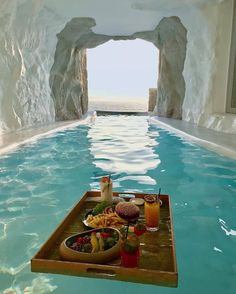 A swimming pool is the ultimate backyard amenity. A swimming pool is Popular Honeymoon Destinations, Travel Destinations, Cavo Tagoo Mykonos, Cave Pool, Bali, Porto Rico, Road Trip, Photography Guide, Travel Photography