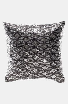 This fabulous silver sequin pillow will add a splash of  modern glitz to the living room.