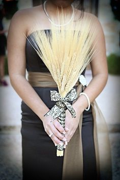 Bouquet made out of dried wheat from craft store wrapped with damask ribbon. Great and easy idea for someone on a tight budget, having a fall themed wedding, or who is allergic to flowers! @Kristen Minor