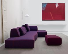 Modern purple sofa with white walls