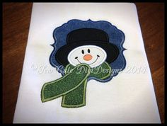 Snowman wearing a scarf within a appliqued by SewCuteDigiDesigns