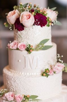 Lace, rose, and monogrammed wedding cake. Classic and beautiful to match any bride!