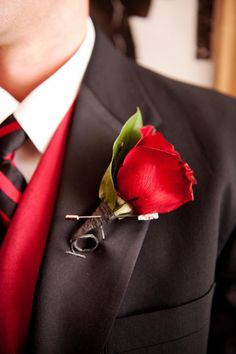 red rose boutonniere // photo by Photo Pink // ruffledblog.com/...