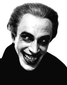 Conrad Veidt as Gwynplaine - 'The Man Who Laughs', 1928.  American silent film directed by the German Expressionist filmmaker Paul Leni.  I'm putting this on my Batman board because this character is said to have inspired the look of The Joker.