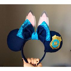 Judy Hopps Zootopia Minnie Mickey Mouse Ears Headband (39 AUD) ❤ liked on Polyvore featuring accessories, hair accessories, hair band accessories, head wrap headband, bow headbands, head wrap hair accessories and sparkly headbands