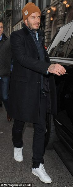 Quick recovery: David Beckham accompanied his wife Victoria on a trip to her London store ...