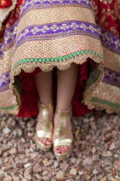 Indian bride in Tarun Tahiliani lehnga and gold sparkly shoes #indianwedding #weddingshoes #goldshoes