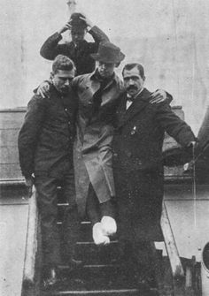 Rescuers from the ship Carpathia helping Titanic's radio operator Harold Bride off ship, Bride's SOS alerted public to sinking of the Titanic