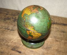This makes me cry. I remember playing with one exactly like it at my Mammaw and Pappaw's house when I was a little girl!  Memories!!!  I truly want this globe!!