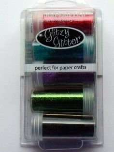 STAMPENDOUS GLITTER KIT - SUPER RICH   Add glitzy accents to cards, scrapbook pages and crafts. Apply over glue, tape or adhesive sheets. The kit contains 5 x 35g glitter pots, Apple Red, Turquoise, Violet, Moss Green, Black.