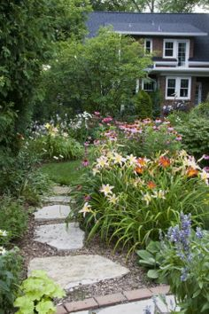 """Today's photos are from Connie Holroyd in Western Springs, Illinois. She says, """"When my husband and I moved into our little English style house in 2001, we faced a back yard rectangle of grass..."""