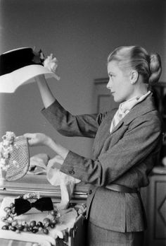 """thefashioncomplex: """" Grace Kelly packing for her trip to Monaco, Lisa Larsen, March 1956 """""""