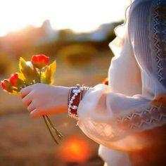 """أنا الذي لالبس فيه  أنادي وضوحك ... وأفرش أبيض روحي  بأنتظار أشراقة ضحكتك ...  لأن صوتك هو مايوقظ الصلوات في آذان العشق ...  هو مايلي كل شيء ليكون معناه . لأني بدونك """" شاغر """" .. نقطة مبهمة المعنى ..  ورقة نائمة في الغبار ..  واجهة لحائط لايؤدي لشيء ..  حديقة دون خضرة .. نبع جاف ..  ولا أولاد يغسلون أحزانه الطويلة Ali Ahmed"""