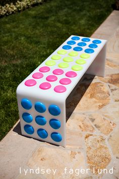 A bench made to look like candy dots! Amazing! This candyland birthday party is fabulous. #candyland #birthday #party #bench #diy
