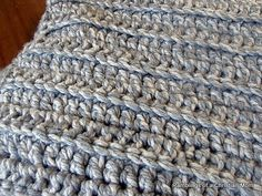 Two strands chunky yarn, double crochet back loops only - I'm definetely trying this one with coral and grey!