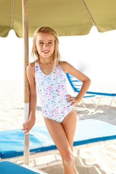Designer kids swimwear - The Peixoto Kids Flamingo consists of both luxury and comfort. This beautiful designer kids printed one piece is cut from great quality fabric and made with a colorful tie dye print. #designerkidsswimwear