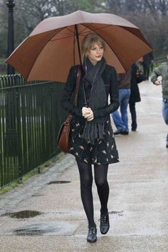 Taylor Swift visits Princess Diana Memorial in London Green Park as well as taking in the swans during the walk alone around Green Park near Buckingham Palace.