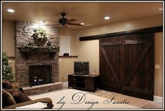 """""""Barn"""" doors made of 2x6's and 1x4's. This covers a patio door in a basement. Great style and security."""