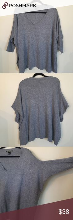 Soft & Cozy Drop-Shoulder Dolman Sweater - M Wonderfully soft and comfortable. Great dressed down with leggings or dressed up with skinny jeans and dainty jewelry. Sleeves are 3/4 length. Oversized with a ribbed V-Neck. Hate to sell it, but I just have too many sweaters in my closet right now! Size M. Not Anthropologie. Listed for styling purposes. Purchased from a local boutique. Anthropologie Sweaters V-Necks