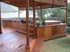 This is similar to what I picture for our future deck but I want it to be wider around the hottub and not quite as high up it because I prefer to step up and in rather than stepping down into it.