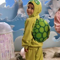 An all-smiles sea turtle gets his fun protective shell from a large plastic bowl covered with green fleece.