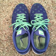 Nike periwinkle sneakers Nike periwinkle background color with lime green polka dots. Great condition size 7 Nike Shoes