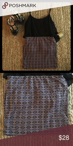 Print High-Waisted Mini Skirt This mini skirt has hues that include blue, gold, and black. You can pair it with a simple black top, and a gold cuff as seen in the picture. It fits like a bandage skirt appearance, making your legs and butt look flawless! It is 72% Polyester and 28% Rayon. 🚫NO TRADES AT THIS TIME Mine Skirts Mini