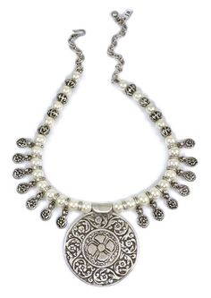 This amazing head-turning statement piece has been crafted out of silver zinc (non-tarnish/hypoallergenic) metal pendant pieces and pearl beads, beaded up the neckline with adjustable hook link closur
