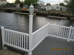 Vinyl Railing on a Trex Deck at the Beach House. Sitting on the Trex Dock by the Bay. Great Railing  Vinyl Railing on a Trex Deck at the Beach House Vinyl Railing, Fence, Trex Decking, Beach House, Mario, House Sitting, Outdoor Decor, Photos, Beach Homes