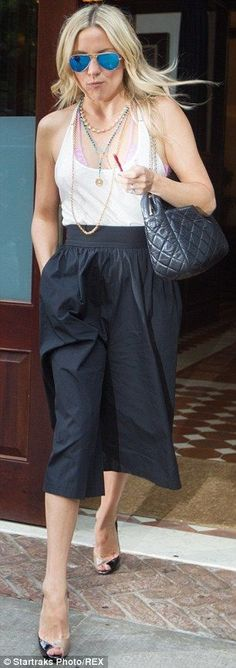 white tee, gaucho pants, Chanel peep toe pumps and bag, and Ray Ban aviator mirrored sunglasses (via Daily Mail)