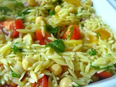 LOVE THIS -- one of my favs!  4 cups chicken broth  1 1/2 cups orzo  1 (15-ounce) can garbanzo beans, drained and rinsed  1 1/2 cups red and yellow cherry tomatoes or grape tomatoes, halved  3/4 cup finely chopped red onion  1/2 cup chopped fresh basil leaves  1/4 cup chopped fresh mint leaves  About 3/4 cup Red Wine Vinaigrette, recipe follows  Salt and freshly ground black pepper