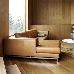 morini sofa from boconcept. love the tan leather with the walls and flooring.