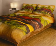 Count calories instead of sheep as you drift off into sleep land cuddled up in the hamburger bedding. Stacked with two beef patties, melted cheese, lettuce, tomato, and fresh onions, this delectable comforter will make bedtime something to look forward to.