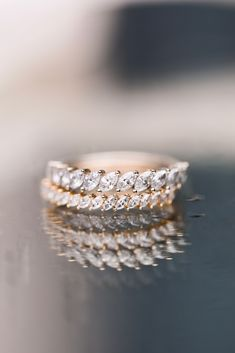 Slanted marquise diamonds in a row. The Domino Marquise Band and Petite Domino Marquise Band provide a domino effect of sparkle. Wear this piece as a wedding band or add it to your everyday stack. Either way, this ring will have you head over heels.