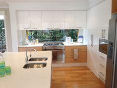 nice shape kitchen and love the greenery visible through window splashback