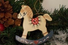 This is a hand painted rocking horse ornament handmade out of thin wood. Has a gold thread for hanging. Design is on one side and base coated on other side and sealed. Has a lot of detail. I'm a free