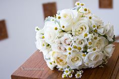 Photo taken by 5th Street Photography - brides bouquet of white spray roses, pale yellow garden roses and adorable little fever few blossoms (mini daisies) by Alluring Blooms
